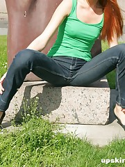 Very slim girl performs sexy poses in her tight dark jeans