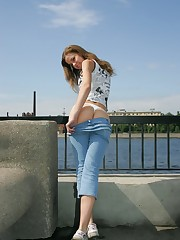 Blue fitting jeans of this girl sexily wrap her slim hips