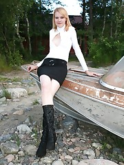 Slim doll in high boots spreads to show fat pussy lips