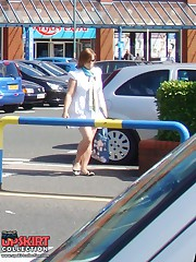 Girl in short skirt caught in street