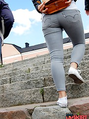 Skin tight jeans wrap the long legs