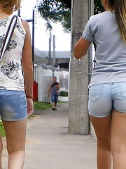 Girls in denim shorts erotically pose