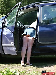 Car upskirt. Stooping chick flashed her great upskirt view upskirt picture