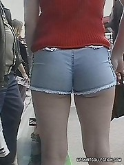 Camera guy spies bubble butts wrapped in tight shorts candid upskirt