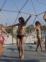 A busty bikini lady undressing on the Cap d'Agde candid upskirt